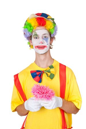 Young man as clown holding pink plastic flower - isolated Stock Photo - 14937557