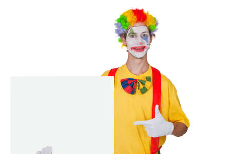 Clown showing white billboard - isolated photo