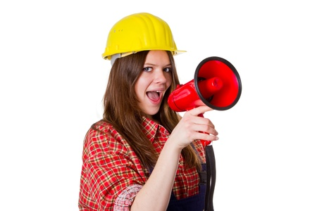 workwoman: Young woman with hardhat speaking into a red megaphone - isolated