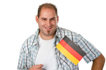 Man with German flag - studio isolated Stock Photo - 14937559
