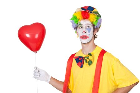 Young man with red heartshaped balloon - isolated Stock Photo - 14937551