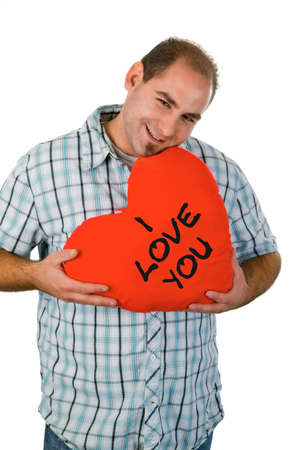 Man holding heart with declaration of love - studio isolated Stock Photo - 14937560