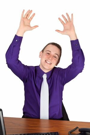 Young businesmann at his desk cheering - isolated Stock Photo - 15291027