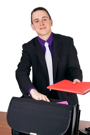 Businessman at his desk presenting a red folder Stock Photo - 15291028