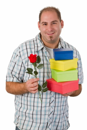 Young man holding gift boxes and plastic rose - isolated Stock Photo - 15291034