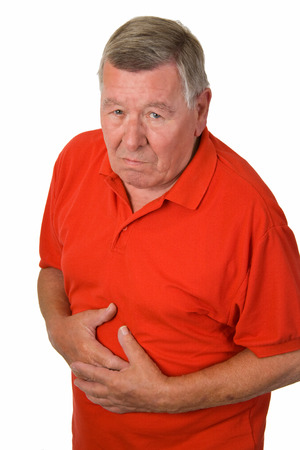 Old man with stomache ache - isolated Standard-Bild