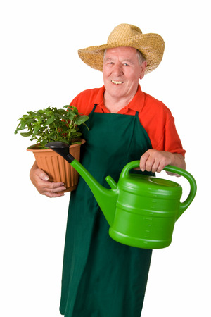 Senior gardener holding watering can and flower pot - isolated photo