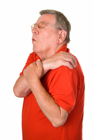 Old man with pain in his shoulder - isolated