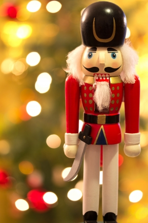 Nutcracker over christmas bokeh background