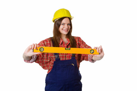 Young woman with hardhat carrying a water-level - isolated photo