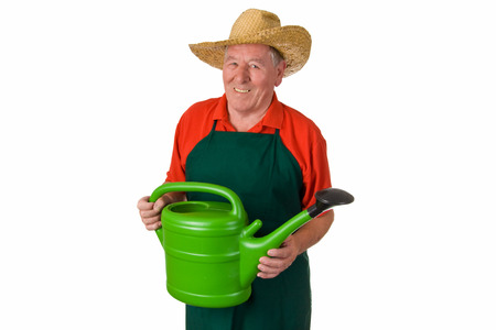 Old gardener holding a watering can - isolated photo