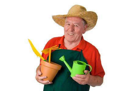 Senior gardener holding gardening tools - isolated photo