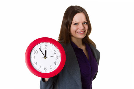 Woman holding a red clock - isolated photo