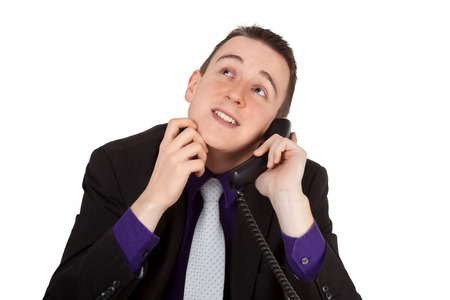 Young businessman on the phone reflecting - isolated photo