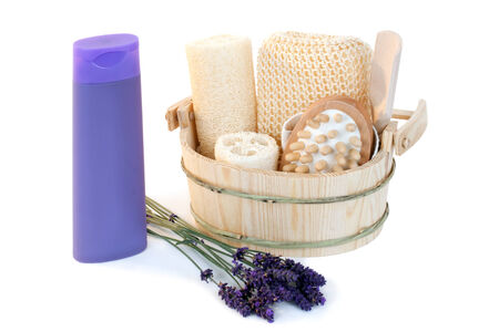 Shower gel with bath supplies and lavender over white background photo
