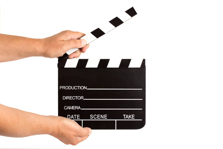 Hands holding clapperboard - isolated