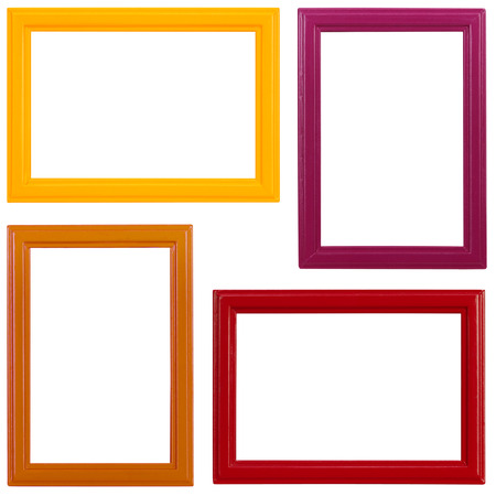 Four multicolored wooden picture frames on white background