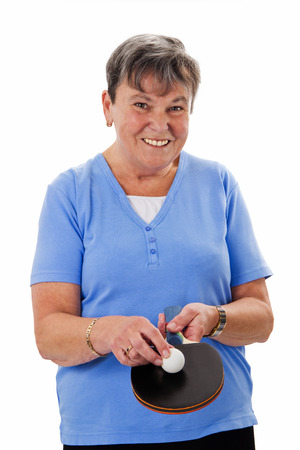 Senior woman with pingpong racket and ball - isolated photo