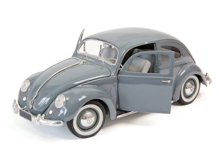 Grey beetle as model car on white background