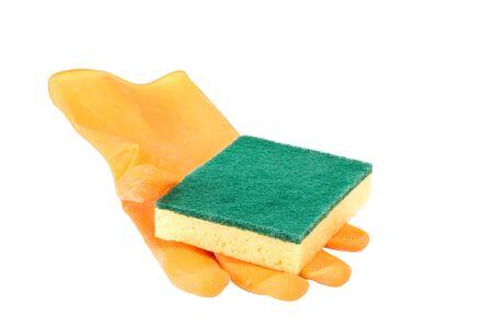 scrubbing: Scrubbing sponge on a yellow rubber glove