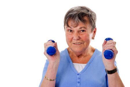 senior woman exercising: Sportive senior woman exercising with dumbbells