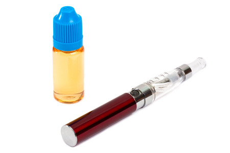 Electronic cigarette and bottle of liquid on white background