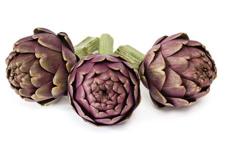 Three fresh artichokes on white background Standard-Bild
