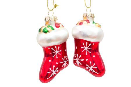 botas de navidad: Un par de botas rojas de Navidad de vidrio aislado en el fondo blanco Foto de archivo