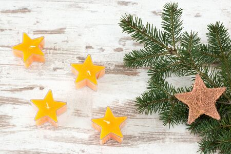 advent candles: Starry advent candles with fir branch on wooden background