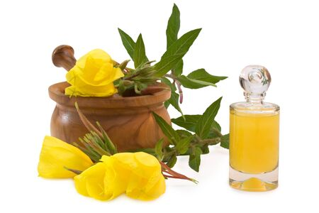 bath supplement: Flask of yellow bath supplement near evening primroses with mortar and pestle