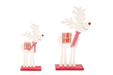 wooden reindeer: Close-up of two wooden reindeer figurines isolated on white background