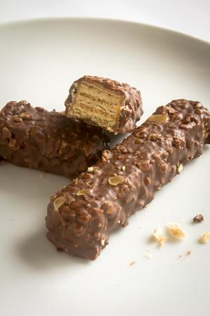 tasty sweet chocolate candy bars isolated white background