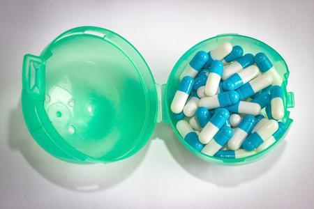 Blue white capsule drug isolated white background Stock Photo
