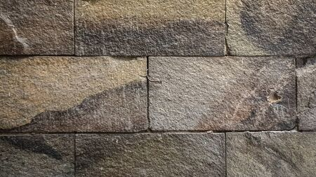 The wall is made of stone with a sturdy shape