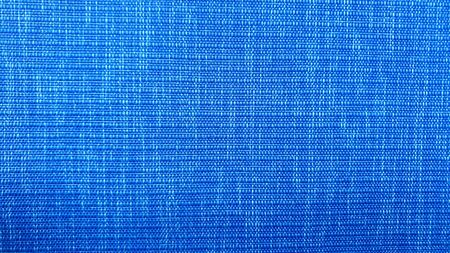 The wall board is blue with fabric as a background in a close up photo