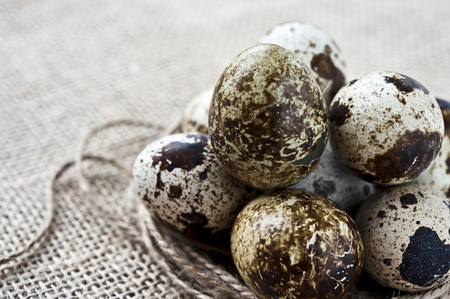 Closeup quail eggs on sack  photo