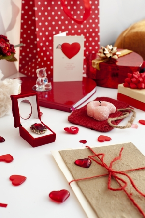 valentine s day teddy bear: Composition of many festive objects-gift boxes, presents, greeting cards, ribbons and jewellery