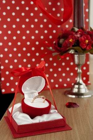 Golden ring in red jewelry box photo