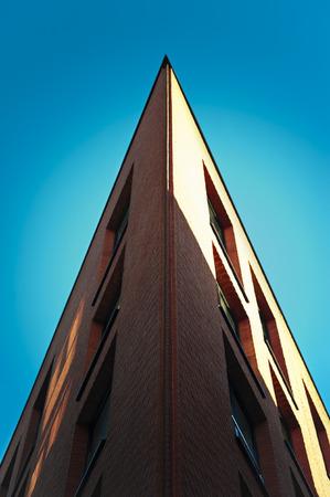 corner house: Corner of red brick modern archicture building