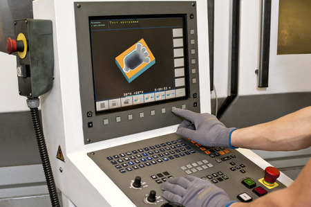 automated tooling: Buttons on computer numerical control programmable machine  Milling industry