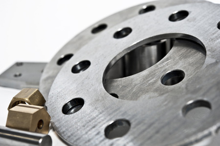 Metal flanges and brass nuts  CNC milling lathe industry  Closeup