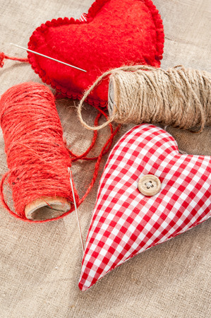 Homemade sewed couple red cotton love heart.   photo