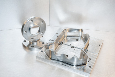 mounting holes: Metal moldblank and steel flanges. Milling industry. CNC technology.