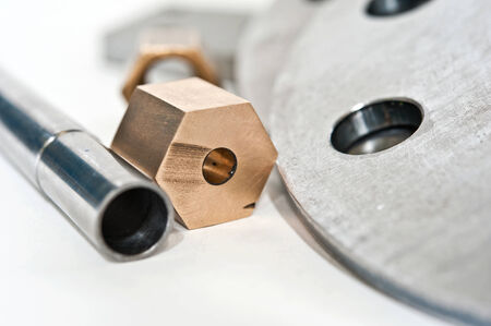 flange: Metal flange pipe and brass nut. Milling and lathe industry. CNC technology. Stock Photo