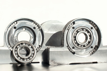 Mounted roller bearing unit CNC technology. Milling lathe and drilling industry. Metalworking. Mechanical engineering. Indoors closeup. Stock Photo