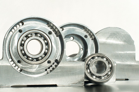mounting holes: Mounted roller bearing unit CNC technology. Milling lathe and drilling industry. Metalworking. Mechanical engineering. Indoors closeup. Stock Photo