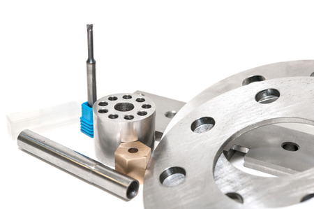 Metal flanges and brass nuts  Metalworking CNC milling lathe industry  Closeup