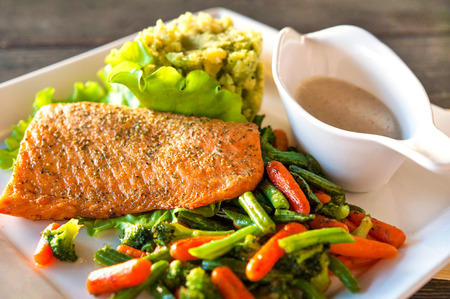 cooked fish: Grilled salmon trout fillet with potato-spinach mash and vegetables  Indoors closeup  Stock Photo
