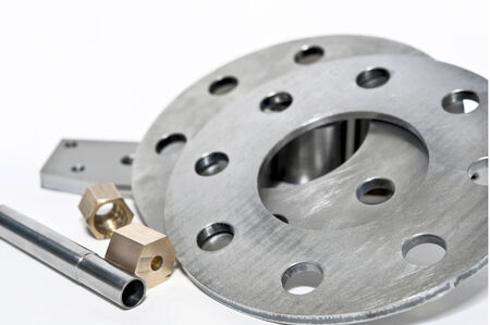 flanges: Closeup metal flanges and brass nuts  CNC milling and lathe industry