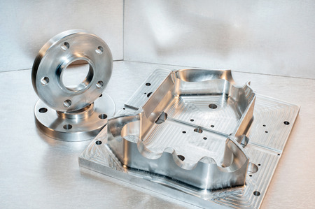 mounting holes: Metal mold blank and steel flanges  Milling and drilling industry  CNC technology